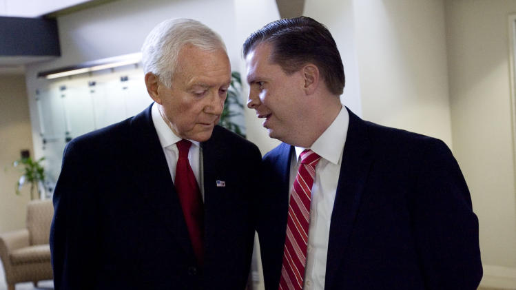 FILE - In this June 15, 2012 file photo, Utah Sen. Orrin Hatch and Dan Liljenquist talk before participating in a debate before the Utah primary election at KSL Newsradio in Salt Lake City.  Hatch said that heís participated in three debates so far with Liljenquist, all untelevised, a number he said still exceeds whatís occurred in other statesí GOP primaries this year. ìI think weíre done,î Hatch said. ìI think folks in Utah have had enough.î (AP Photo/The Deseret News, Laura Seitz, Pool, File )