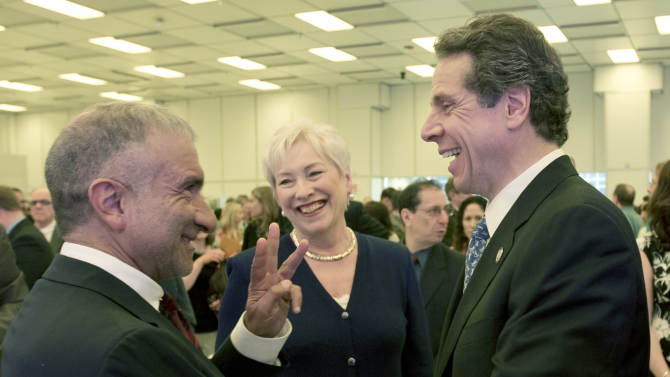 New York Gov. Andrew Cuomo, right talks with Alain Kaloyeros of the College of Nanoscale Science and Engineering at the University at Albany, left, and State University of New York Chancellor Nancy Zimpher after a news conference on Wednesday, May 22, 2013, in Albany, N.Y. Cuomo wants to create tax-free entrepreneurial zones tied to State University of New York campuses. Cuomo's proposal would give full tax credits to new businesses in select communities with state college campuses. (AP Photo/Mike Groll)