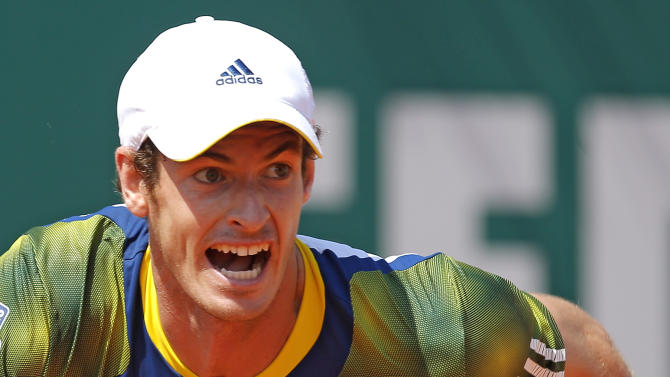 Andy Murray of Britain plays a return to Stanislas Wawrinka of Switzerland during their match of the Monte Carlo Tennis Masters tournament in Monaco, Thursday, April 18, 2013. (AP Photo/Lionel Cironneau)