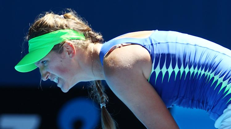 Victoria Azarenka of Belarus reacts after winning  a point against Kim Clijsters of Belgium during their semifinal at the Australian Open tennis championship, in Melbourne, Australia, Thursday, Jan. 26, 2012. (AP Photo/Rick Rycroft)