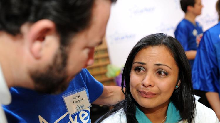 IMAGE DISTRIBUTED FOR STARKEY HEARING FOUNDATION - Dania Orellana cries after being fitted with a new hearing aid from the Starkey Hearing Foundation on Saturday, Feb. 2, 2013 in New Orleans. (Photo by Cheryl Gerber/Invision for Starkey Hearing Foundation/AP Images)