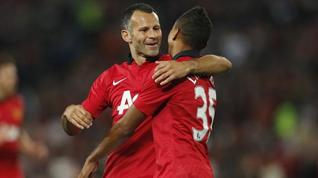Manchester United's Jesse Lingard (R) celebrates with team mate Ryan Giggs after scoring against A-League All Star XI