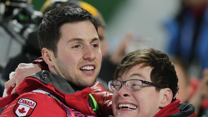 Canada's Alex Bilodeau, left, celebrates with his brother Frederic after winning the gold medal in the men's moguls final at the Rosa Khutor Extreme Park at the 2014 Winter Olympics, Monday, Feb. 10, 2014, in Krasnaya Polyana, Russia