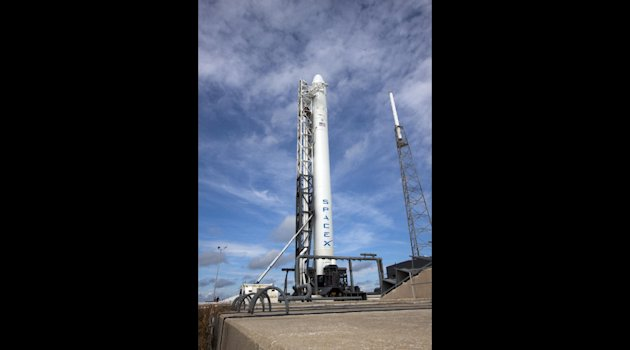 In this image provided by NASA the Space Exploration Technologies Corp., or SpaceX, Falcon 9 rocket with it's Dragon capsule attached on top is seen at Space Launch Complex-40 at Cape Canaveral Air Force Station in Florida Oct. 2, 2012. The coming mission is the first under a $1.6 billion contract with NASA that calls for a dozen resupply flights by SpaceX, essential in the post-shuttle era. The liftoff is planned for Sunday morning, Oct. 7, at 8:35 p.m. EDT. (AP Photo/NASA)