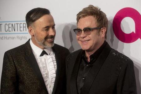 Gay British musician Elton John marries partner under new law
