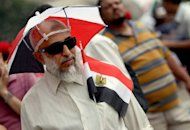An Egyptian man walks in Cairo's Tahrir Square. Tensions soared in Egypt on Saturday a day before the result of a divisive presidential election and as the Muslim Brotherhood sparred with the ruling generals over what it sees as a military power grab