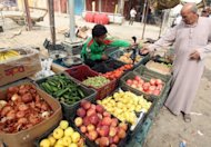 Iraqi Paralympian Ahmed Naas at his family's fruit and vegetable stall in his hometown of Batha. Despite combined prize money from various Iraqi government sources of around $33,000, Naas is back to work at his family's grocery stall