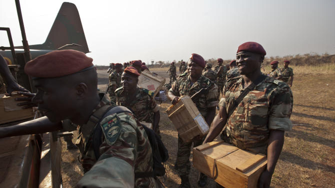 The final contingent of reinforcements under current deployment plans, a group of around forty soldiers from Cameroon, load munitions into trucks after arriving to bolster the multinational central-african regional force known as FOMAC which now numbers around a thousand troops, at the airport in Bangui, Central African Republic Thursday, Jan. 3, 2013. Facing an insurgency by a new rebel coalition, Central African Republic President Bozize consolidated military power under his control Thursday after dismissing his own son as acting defense minister along with his army chief of staff. (AP Photo/Ben Curtis)