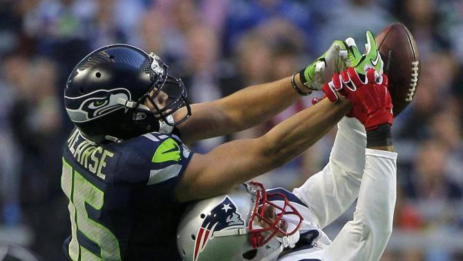Seattle Seahawks strong safety Shead and New England Patriots cornerback Ryan fight for an incomplete pass in the first half during the NFL Super Bowl XLIX football game in Glendale
