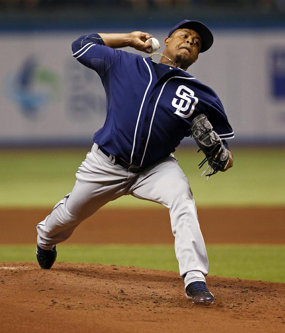 San Diego Padres starting pitcher Edinson Volquez throws during the first inning of a baseball game against the Tampa Bay Rays, Friday, May 10, 2013, in St. Petersburg, Fla. (AP Photo/Mike Carlson)
