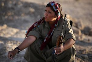 A picture taken on August 21, 2014 shows a woman Kurdistan …