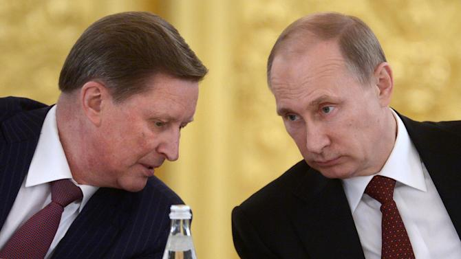 Kremlin's Chief of Staff Sergei Ivanov, left, speaks to Russian President Vladimir Putin during a Council of Physical Fitness and Sports in the Kremlin in Moscow, Russia, Monday, March 24, 2014. (AP Photo/RIA-Novosti, Alexei Nikolsky, Presidential Press Service)