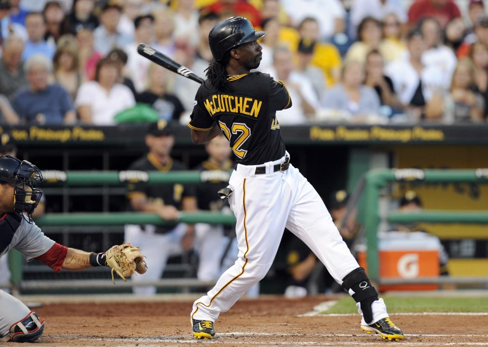 Pittsburgh Pirates' Andrew McCutchen (22) watches the ball clear the wall on a three-run home run against the St. Louis Cardinals during the third inning of a baseball game Tuessday, Aug. 16, 2011 in Pittsburgh.(AP Photo/Don Wright)