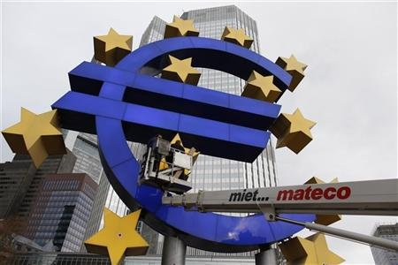 Workers maintain the huge Euro logo in front headquarters of ECB in Frankfurt