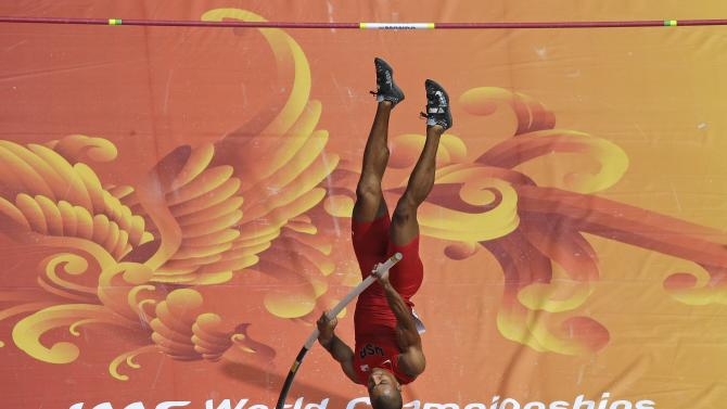 United States' Ashton Eaton competes in the decathlon pole vault at the World Athletic Championships at the Bird's Nest stadium in Beijing, Saturday, Aug. 29, 2015.  (AP Photo/Wong Maye-E)