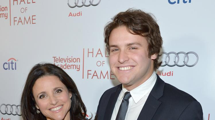 Julia Louis-Dreyfus, left, and Henry Hall arrive at the 2014 Television Academy Hall of Fame on Tuesday, March 11, 2014, at the Beverly Wilshire in Beverly Hills, Calif. (Photo by John Shearer/Invision for the Television Academy/AP Images)