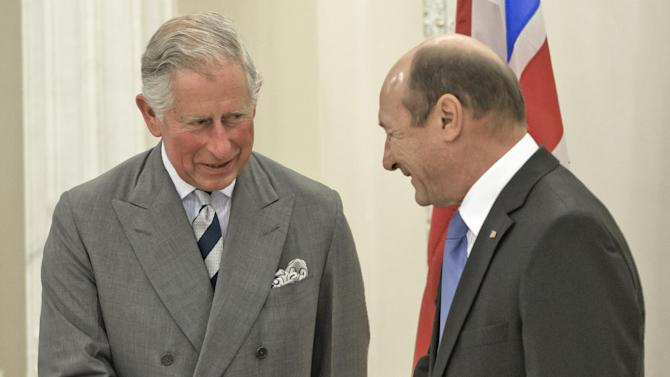 Britain's Prince Charles, left, shakes hands with Romania's President Traian Basescu, right, at the Cotroceni Presidential Palace in Bucharest, Romania. Monday, June 3, 2013.(AP Photo/Vadim Ghirda)