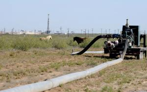 Large hoses go from one hydraulic fracturing drill…