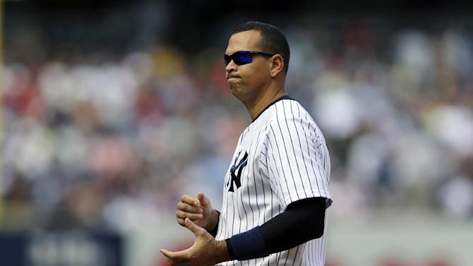 New York Yankees' Alex Rodriguez reacts after flying out to center field with Alfonso Soriano on second during the seventh inning of a baseball game against the Los Angeles Angels, Thursday, Aug. 15, 2013, in New York. (AP Photo/Kathy Willens)