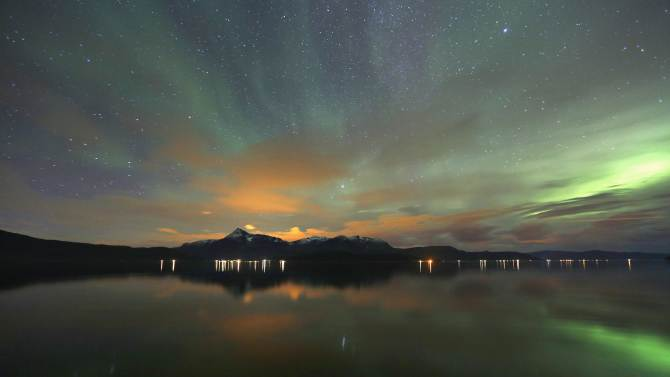 Tthe Aurora Borealis (Northern Lights) is seen over the Bals-Fiord near the village of Mestervik, north of the Arctic Circle