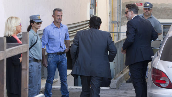 Captain Francesco Schettino, center with back to camera, arrives with his lawyer Francesco Pepe, right, at the court room of the converted Teatro Moderno theater for his trial, in Grosseto, Italy, Monday, Sept. 23, 2013. Schettino is charged with manslaughter, causing the shipwreck and abandoning the Costa Concordia before all aboard were evacuated after it crashed into a reef off the Tuscan island of Giglio in January 2012, killing 32 people. The trial of the captain of the ship resumed Monday after a two-month summer recess, during which a salvage operation took place to upright the wreck. (AP Photo/Andrew Medichini)