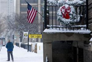 A person walks down a snow-covered sidewalk in Milwaukee, Wisconsin