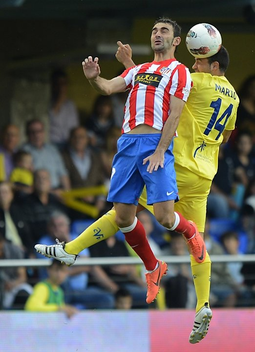 Atletico Madrid's Midfielder Adrian Lopez (L) Vies AFP/Getty Images