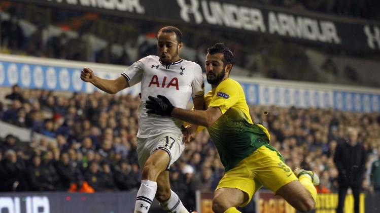 Tottenham Hotspur's Andros Townsend is challenged by Anzhi Makhachkala's Gia Grigalava during their Europa League soccer match at White Hart Lane in London