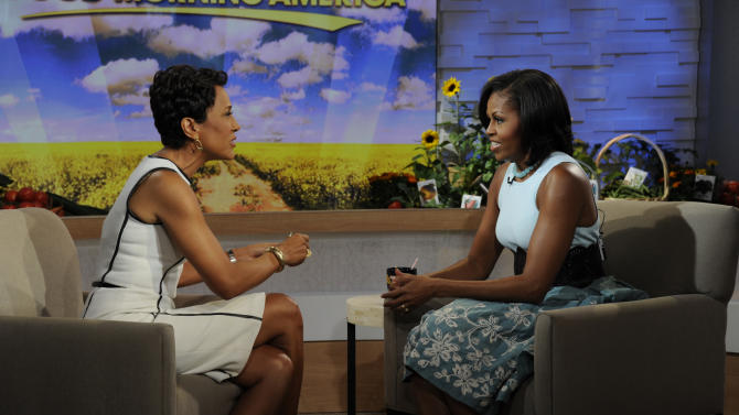 """This image released by ABC shows  host Robin Roberts, left, speaking with first lady Michelle Obama on the morning program """"Good Morning America,"""" Tuesday, May 29, 2012 in New York. Obama discussed a variety of topics including her new book """"American Grown: The Story of the White House Kitchen Garden and Gardens Across America,"""" which promotes healthy eating. (AP Photo/ABC, Ida Mae Astute)"""