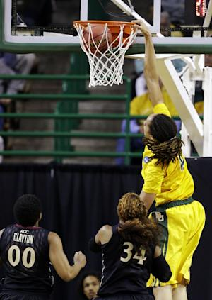 Florida State's Chasity Clayton (00) and Chelsea Davis (34) watch as Baylor center Brittney Griner (42) dunks in the first half of a second-round game in the women's NCAA college basketball tournament, Tuesday, March 26, 2013, in Waco, Texas. (AP Photo/Tony Gutierrez)