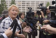 Quebec Premier Pauline Marois responds to reporters questions over a proposed Charter of Quebec values while walking to her office to attend a cabinet meeting Wednesday, September 11, 2013 at the legislature in Quebec City. THE CANADIAN PRESS/Jacques Boissinot