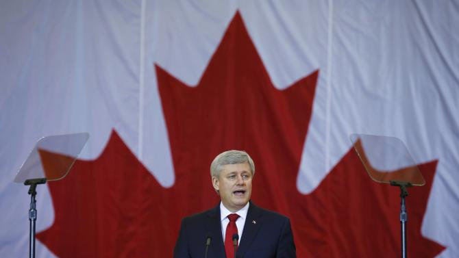 Canadian Prime Minister Stephen Harper speaks at a news conference in Richmond Hill