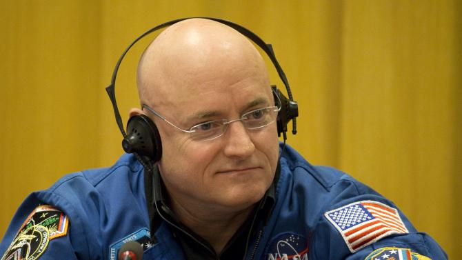 NASA astronaut Scott Kelly attends a news conference to preview the upcoming year-long expedition and to discuss the future of the International laboratory at the UNESCO Headquarters in Paris