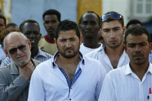 Syrian and Sub-Saharan African migrants attend a commemorative service for immigrants who lost their lives at sea earlier this month, at Valletta's Grand Harbour