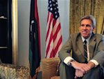 Christopher Stevens, the U.S. ambassador to Libya, smiles at his home in Tripoli