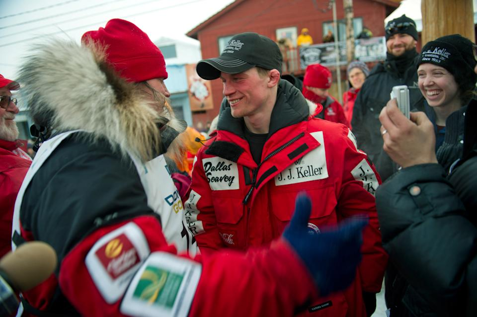 Aliy Zirkle, left, gets a hug  from Dallas Seavey at the finish line of the Iditarod Trail Sled Dog Race in Nome, Alaska, on Tuesday, March 13, 2012. Seavey won the race and Zirkle placed second. (AP Photo/Marc Lester, Anchorage Daily News )