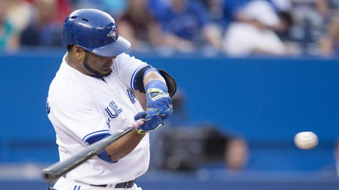 Toronto Blue Jays' Edwin Encarnacion hits an RBI-doubleagainst the Detroit Tigers during first-inning baseball game action in Toronto, Friday, Aug. 28, 2015. (Darren Calabrese/The Canadian Press via AP) MANDATORY CREDIT