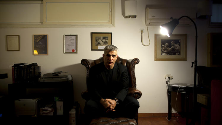 Yair Lapid, popular former TV anchorman and head of the new centrist party Yesh Atid, poses for a portrait at his house during an interview for the Associated Press, in Tel Aviv, Israel, Wednesday, June. 16, 2013. Lapid predicted he will one day become prime minister and said he would fight for a more moderate policy towards the Palestinians. (AP Photo/Oded Balilty)
