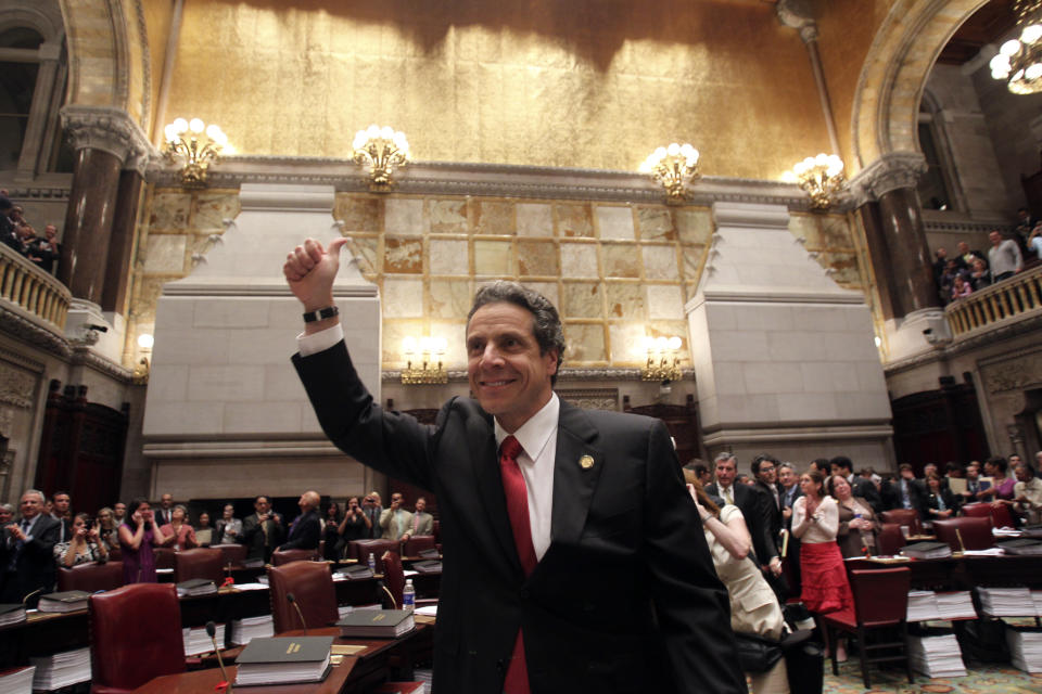 New York Gov. Andrew Cuomo reacts after same sex marriage was legalized after a vote in the Senate Chamber at the Capitol in Albany, N.Y., on Friday, June 24, 2011.  (AP Photo/Mike Groll)