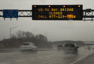 A sign spanning Interstate 97 South in Millersville, Md., Wednesday, March 6, 2013, alerts travelers that the Chesapeake Bay Bridge is closed in both directions because of high winds, according to he Maryland Transportation Authority. (AP Photo/Carolyn Kaster)