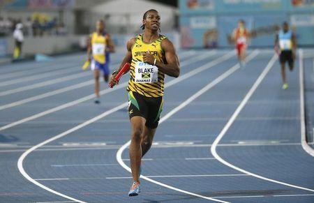 Jamaica's Yohan Blake crosses the finish line to win the 4x200 metres relay while setting a new world record at the IAAF World Relays Championships in Nassau