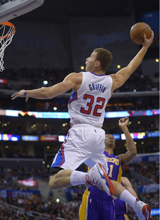 Los Angeles Clippers forward Blake Griffin goes up for a dunk as Los Angeles Lakers guard Wesley Johnson defends during the first half of an NBA basketball game, Friday, Jan. 10, 2014, in Los Angeles.