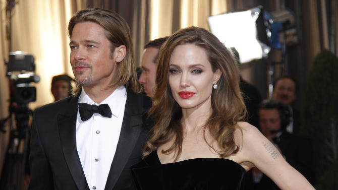 FILE -  In this Sunday, Feb. 26, 2012 file photo, actress Angelina Jolie, right, and actor Brad Pitt arrive before the 84th Academy Awards, in the Hollywood section of Los Angeles. At the London Olympics, away from the track and field, Hollywood royalty such as Pitt and Jolie will be rubbing shoulders with diplomats and businessmen at the city's glitziest clubs and grandest historic buildings. (AP Photo/Amy Sancetta, File)