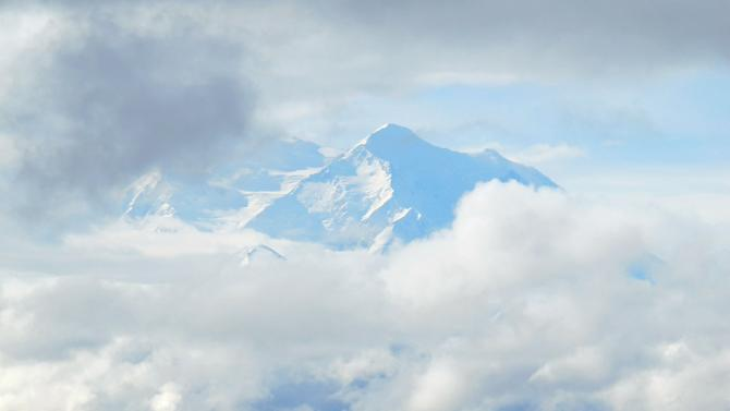 In this Sept. 11, 2011 photo, clouds obscure a portion of Mount McKinley, in Denali National Park and Preserve, Alaska. (AP Photo/Becky Bohrer)