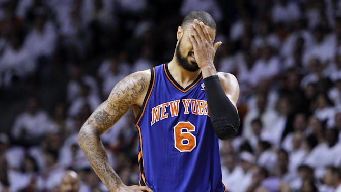 New York Knicks' Tyson Chandler (6) reacts after being called for a technical foul in the first half of an NBA basketball game against the Miami Heat in the first round of the Eastern Conference playoffs in Miami, Monday, April 30, 2012. (AP Photo/Lynne Sladky)
