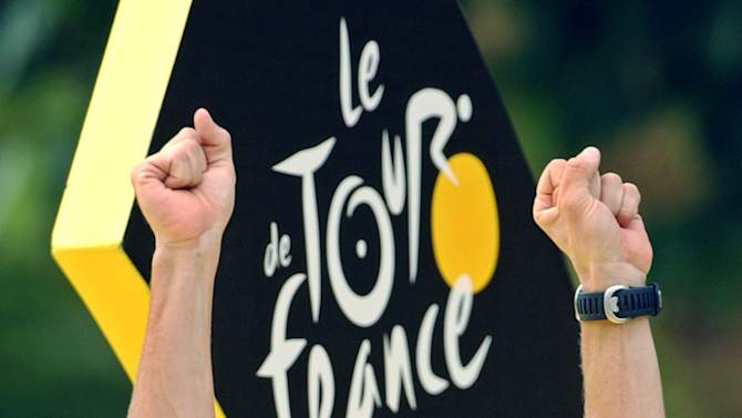 FILE - This July 27, 2003 file photo shows Lance Armstrong waving on the podium after he won his fifth consecutive Tour de France cycling race, in Paris. Armstrong was stripped of his seven Tour de France titles and banned for life by cycling's governing body Monday, Oct. 22, 2012, following a report from the U.S. Anti-Doping Agency that accused him of leading a massive doping program on his teams. UCI President Pat McQuaid announced that the federation accepted the USADA's report on Armstrong and would not appeal to the Court of Arbitration for Sport.  (AP Photo/Peter Dejong, File)