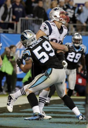 Carolina Panthers' Luke Kuechly (59) blocks New England Patriots' Rob Gronkowski (87) on the final play during the second half of an NFL football game in Charlotte, N.C., Monday, Nov. 18, 2013. The Panthers won 24-20. (AP Photo/Chuck Burton)
