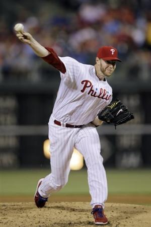 Halladay helps Phillies beat Cardinals