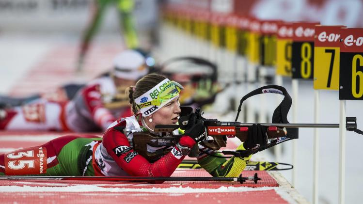 Darya Domracheva of Belarus takes aim at the shooting range during the women's 15 km individual IBU biathlon World Cup competition in Ostersund