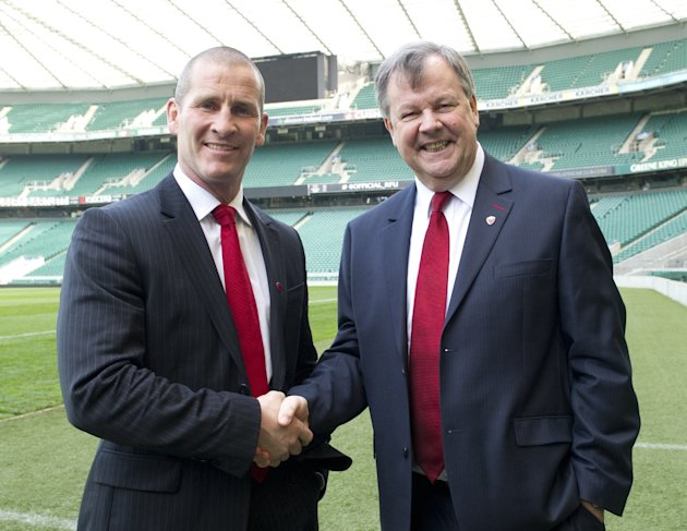 Stuart Lancaster (L), the new head coach of England's rugby union team and Ian Ritchie, Rugby Football Union (RFU) chief executive, pose for photographers before a press conference in Twickenham stadi